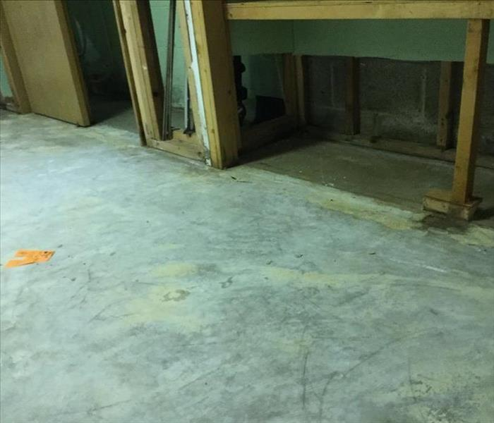 basement after carpet and drywall were removed and water extracted