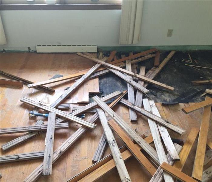 Demo of water damaged hardwood floors