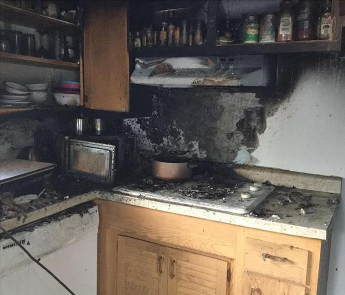 photo of aftermath after fire in kitchen of homeowner